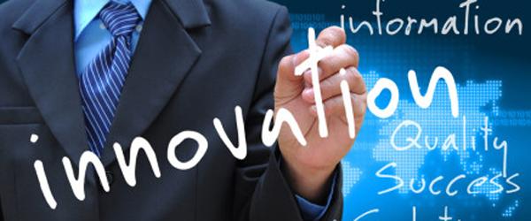 businessman hand writing innovation