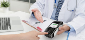 Payment for private medical care. Pos terminal at doctor office